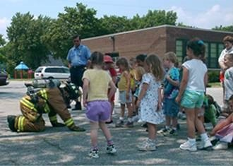 Children being educated about fire safety