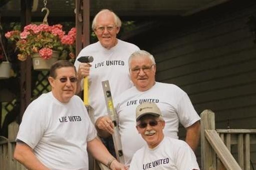 Four men in Live United t shirts