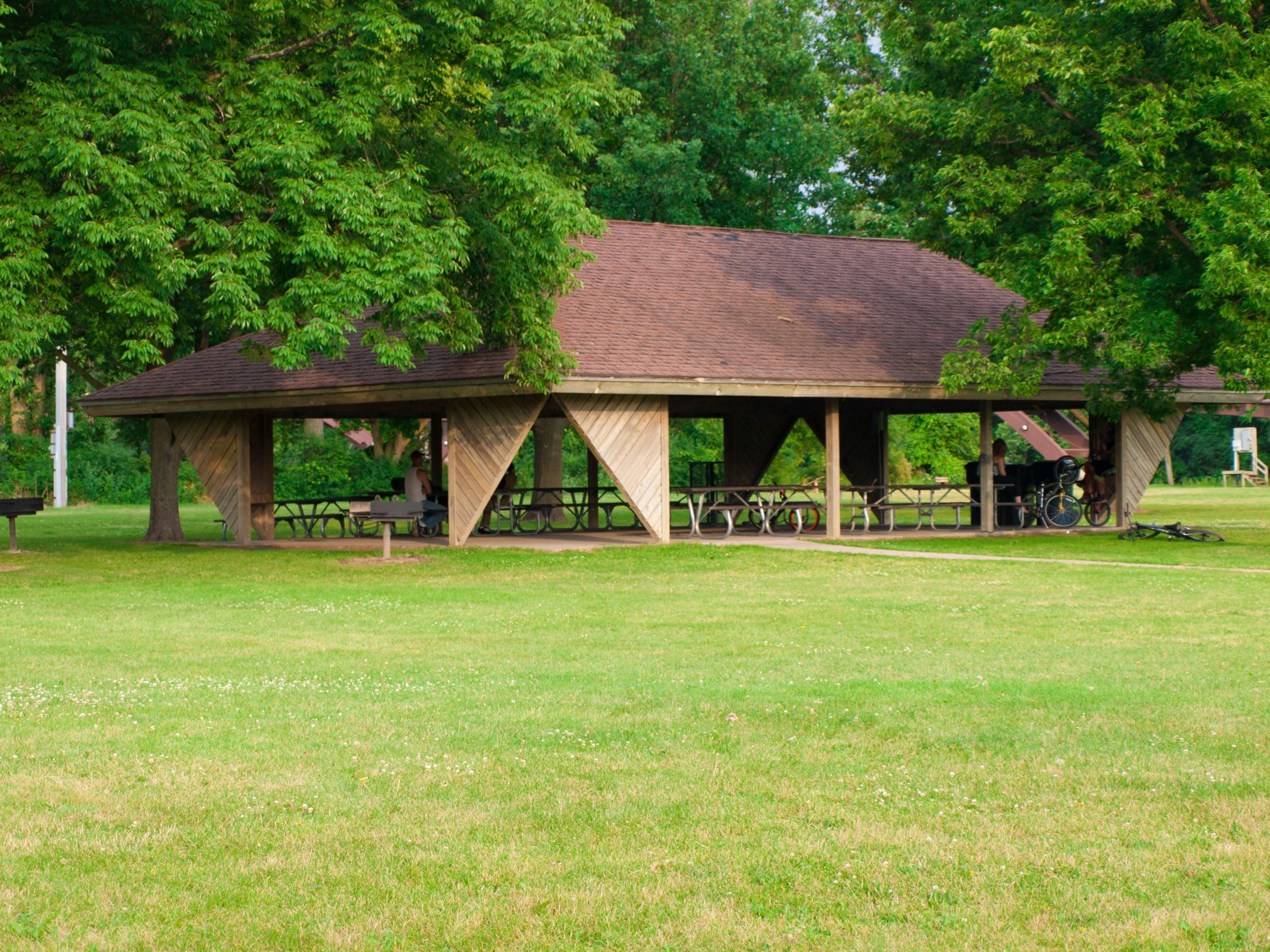 Image of an outdoor pavilion under trees