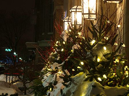 Streetscape in Downtown Midland with christmas trees, snow, and lighting
