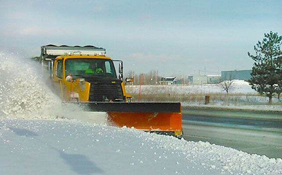 A yellow City snow plow on Poseyville Road