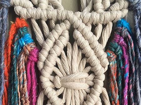 A brightly colored macrame design from yarn