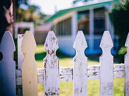 A white picket fence in a nice neighborhood