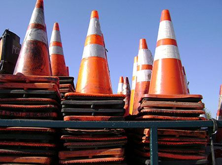 Orange traffic cones on a blue sky