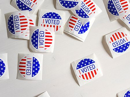 "Red, white, and blue stickers that say ""I Voted"""