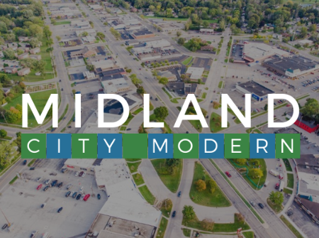 A white, green, and blue Midland City Modern logo over an aerial of the Circle