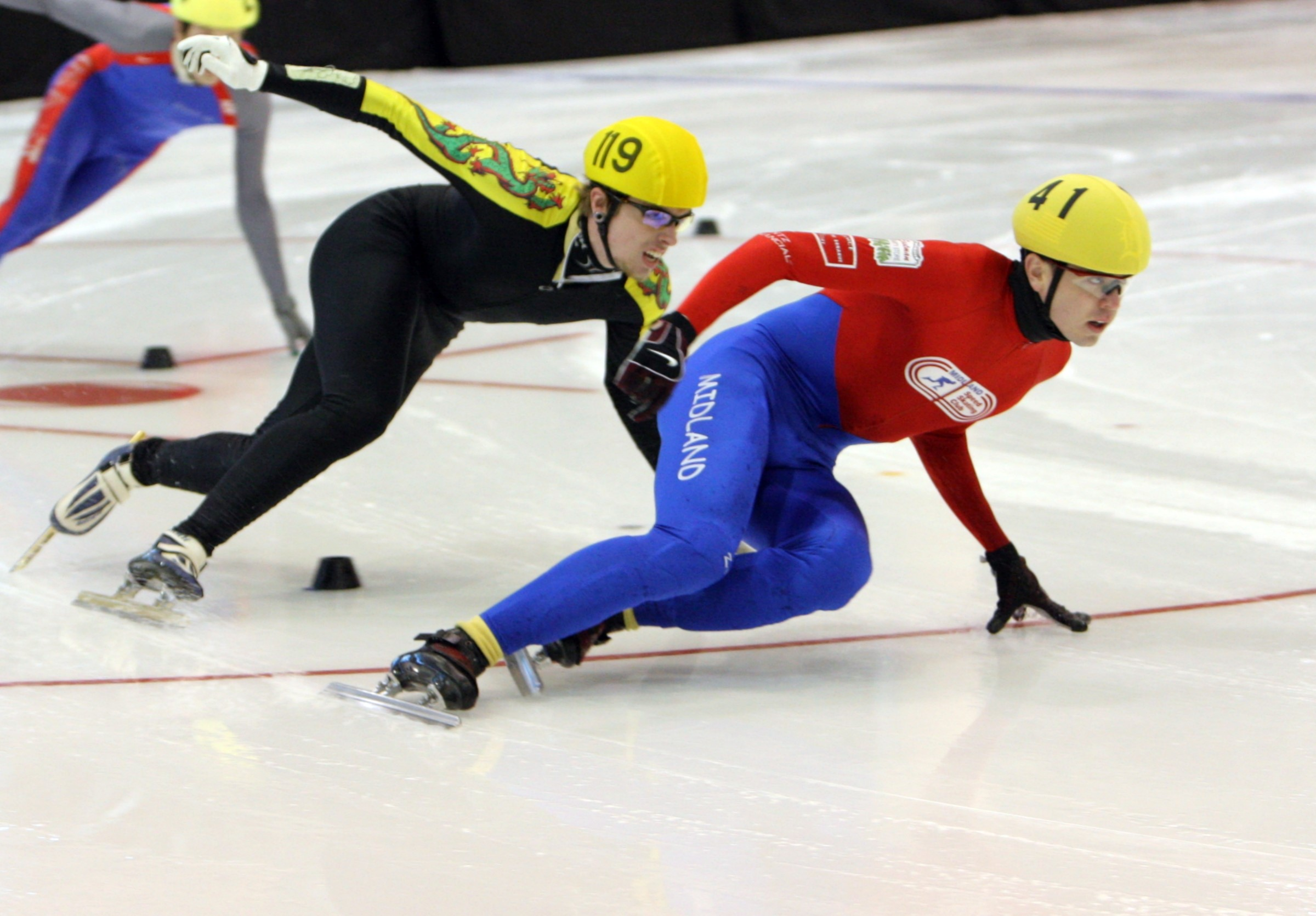 Two speed skaters on rink