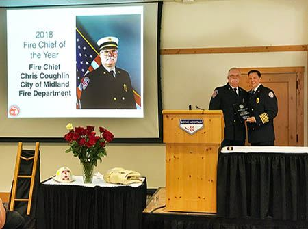 Chris Coughlin is awarded the 2018 MACF Fire Chief of the Year